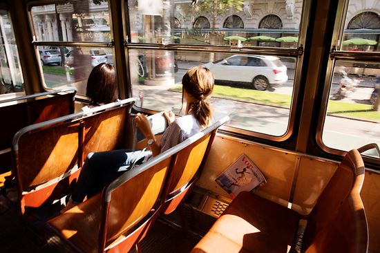Two women are riding in a tram on Vienna's Ringstrasse boulevard