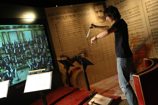 Man conducts a virtual orchestra