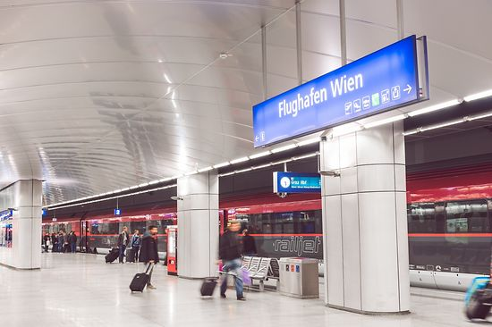 Railjet Express Train in the Vienna Airport Train Station with travelers