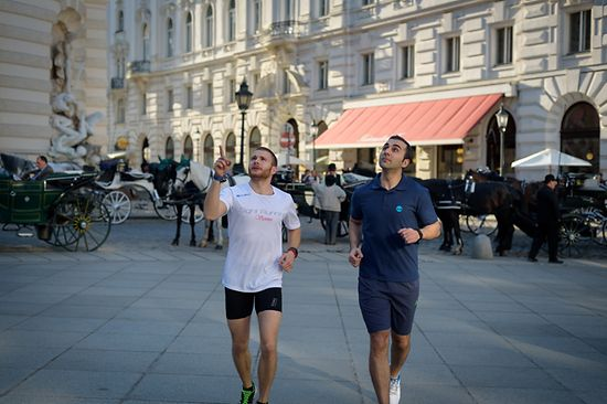 Two men jogging in the Vienna city center