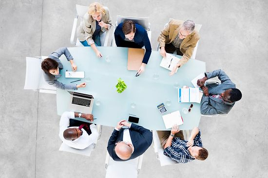 Group of people at conference table