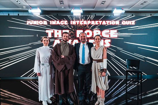 Four persons with Star Wars backdrop